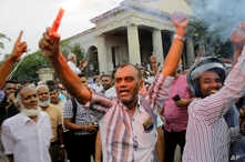 Supporters of ousted Sri Lankan Prime Minister Ranil Wickremesinghe celebrate outside the supreme court complex in Colombo, Dec. 13, 2018.