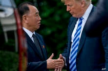 FILE - President Donald Trump shakes hands with Kim Yong Chol, former North Korean military intelligence chief, after their meeting in the Oval Office of the White House in Washington, June 1, 2018. The two also met for talks in Washington on Jan. 18