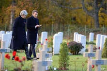 British Prime Minister Theresa May and French President Emmanuel Macron visit the Thiepval cemetery as part of ceremonies to mark the centenary of the 1918 Armistice, in Thiepval, northern France, Nov. 9, 2018. The memorial commemorates more than 72,