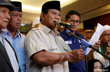 Indonesia's presidential candidate Prabowo Subianto delivers a speech to declare election victory as his running mate Sandiaga Uno stands next to him in Jakarta, Indonesia, April 18, 2019.