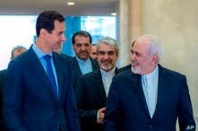 Photo released on the official Facebook page of Syrian Presidency shows Syrian President Bashar Assad (L) speaking with Iranian Foreign Minister Mohammad Javad Zarif in Damascus, Syria, April 16, 2019.
