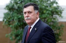Libyan Prime Minister Fayez al-Sarraj leaves after an international conference on Libya at the Elysee Palace in Paris, May 29, 2018.