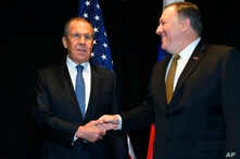 U.S. Secretary of State Mike Pompeo, right, shakes hands with Russia's Foreign Minister Sergei Lavrov as they meet on the sidelines of the Arctic Council Ministerial Meeting in Rovaniemi, Finland, May 6, 2019.
