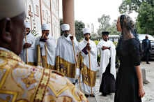 Clergy line the steps of the Holy Trinity Cathedral as White House senior adviser Ivanka Trump, right, arrives for a ceremony honoring the victims of the Ethiopian Airlines crash, Monday April 15, 2019, in Addis Ababa, Ethiopia.
