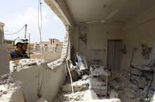 A member of the Syrian Civil Defense (The White Helmet) checks the rubble and debris at a medical center following reported shelling by the Syrian government, in Hbeit in the southern countryside of the rebel-held Idlib province, April 30, 2019.