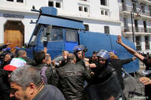 Police officers disperse people protesting after parliament appointed upper house chairman Abdelkader Bensalah as interim president following the resignation of Abdelaziz Bouteflika in Algiers, Algeria, April 9, 2019.