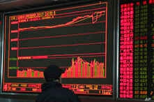 An investor monitors prices at a stock brokerage in Beijing on Tuesday, April 23, 2019. Asian stocks were mixed on Tuesday while oil prices soared to their highest level since October after the U.S. said it would soon impose sanctions on all buyers o...