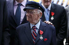 FILE - Benjamin B. Ferencz pose for a picture after he received the Legion of Honor Insignia from French minister of Defense Jean-Yves Le Drian  during an awards ceremony to honor World War II veterans in New York, July 3, 2015.