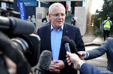 FILE - Australian Prime Minister Scott Morrison speaks to the media as he arrives at the Horizon Church in Sutherland in Sydney, Australia, May 19, 2019.