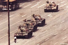 FILE - A man stands in front of a convoy of tanks in the Avenue of Eternal Peace in Beijing, China, June 5, 1989.