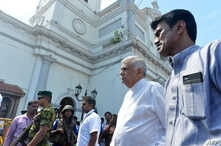 FILE - Sri Lankan Prime Minister Ranil Wickremasinghe (2nd R) arrives to visit the site of a bomb attack at St. Anthony's Shrine in Kochchikade in Colombo on April 21, 2019.