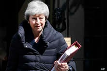 Britain's Prime Minister Theresa May leaves 10 Downing Street for the House of Commons for her weekly Prime Minister's questions in London, Wednesday, May 1, 2019.