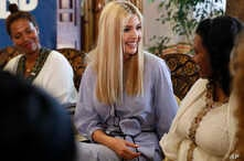 White House senior adviser Ivanka Trump, center, smiles at Azalech Tesfaye, right, who is the recipient of loan guarantee through USAID, as Trump meets women who work in the Ethiopian coffee industry, Sunday April 14, 2019, at Dumerso Coffee in Addis...