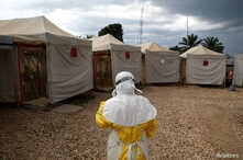 FILE PHOTO: A health worker wearing Ebola protection gear, prepares to  enter the Biosecure Emergency Care Unit at the Alliance for International Medical Action ebola treatment center in Beni, DRC, March 30, 2019.