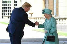Britain's Queen Elizabeth II greets President Donald Trump as he arrives for a welcome ceremony in the garden of Buckingham Palace, in London, June 3, 2019, on the first day of a three day state visit to Britain.