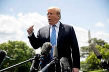 FILE - President Donald Trump speaks to members of the media on the South Lawn of the White House in Washington, May 14, 2019.