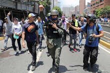 A Venezuelan National Guard joins anti-government protesters in a march showing support for opposition leader Juan Guaido in Caracas, Venezuela April 30, 2019.