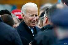 Former vice president Joe Biden talks with officials after speaking at a rally in support of striking Stop & Shop workers in Boston, April 18, 2019.