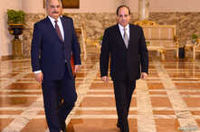 Libyan military commander Khalifa Haftar walks with Egyptian President Abdel Fattah el-Sissi at the Presidential Palace in Cairo,Apr. 14, 2019 in this handout picture courtesy of the Egyptian Presidency.