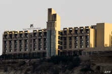 FILE - The five-star Pearl Continental hotel is seen on a hill in the southwestern Pakistani port city of Gwadar, March 8, 2019.
