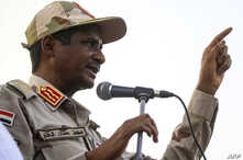 Mohamed Hamdan Dagalo, deputy head of Sudan's ruling Transitional Military Council gives a speech in the village of Qarri, June 15, 2019.