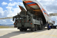 Military vehicles and equipment, parts of the S-400 air defense systems, are unloaded from a Russian transport aircraft, at Murted military airport in Ankara, Turkey, July 12, 2019.