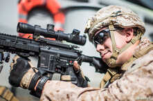 A U.S. Marine Corps rifleman with Kilo Company, Battalion Landing Team 3/5, provides security aboard the amphibious assault ship USS Boxer during its transit through Strait of Hormuz in Gulf of Oman, Arabian Sea, July 18, 2019.