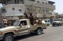 In this frame grab from video provided by Yemen Today, Yemeni army vehicles enter Zinjibar, Yemen, Aug. 28, 2019.