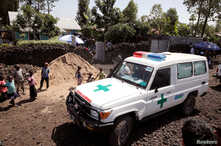 FILE - An ambulance waits next to a clinic to transport a suspected Ebola patient, in Goma, Democratic Republic of the Congo, Au