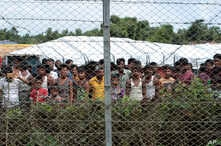Displaced Rohingya are seen in a fenced-in camp during a government-organized media tour to a no-man's land between Myanmar and Bangladesh, near Taungpyolatyar village, Maung Daw, northern Rakhine State, Myanmar, June 29, 2018.