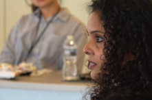 Rana Ayyub speaking at a conference in Washington DC