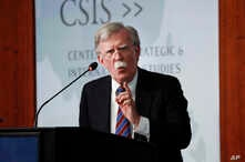Former National security adviser John Bolton gestures while speaking at the Center for Strategic and International Studies in Washington, Sept. 30, 2019.