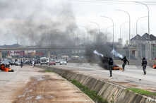 Policemen shoot canister of tear gas to disperse people during a demonstration and attacks against South Africa's owned shops in Abuja, Nigeria, Sept. 4, 2019.