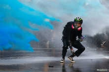 An anti-government protester is sprayed with blue-colored water by the police during a demonstration near Central Government Complex in Hong Kong, China, Sept.15, 2019.
