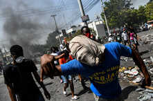 Protesters march on the street to demand the resignation of President Jovenel Moise in Port-au-Prince, Haiti on October 11,…