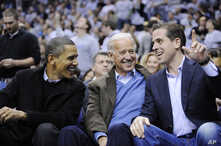 President Barack Obama, left, talks with Vice President Joe Biden, center, and his son Hunter Biden, right, at the Duke…