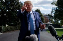President Donald Trump talks to reporters on the South Lawn of the White House, Oct. 4, 2019, in Washington.