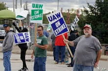 John Kirk, right, a 20-year-employee, pickets with co-workers outside the General Motors Fabrication Division, Oct. 4, 2019, in Parma, Ohio.