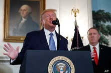 President Donald Trump, accompanied by Secretary of State Mike Pompeo, speaks Wednesday, Oct. 23, 2019, in the Diplomatic Room…