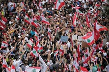 Anti-government protesters shout slogans in Beirut, Lebanon, Oct. 20, 2019.