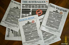 """Front pages of Australian major newspapers show a 'Your right to know"""" campaign, in Canberra."""