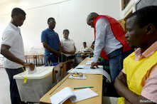 A man casts his vote during the presidential, legislative and provincial elections in Maputo, Mozambique, Oct., 15, 2019.