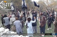 Fighters with IS-Khorasan, the affiliate in Afghanistan, vow allegiance to new Islamic State leader Abu Ibrahim al-Hashimi al-Qurashi, in this photo issued Nov. 5, 2019, by SITE Intelligence Group.