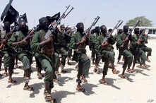 FILE - Al-Shabab fighters march during military exercises in the Lafofe area, some 18 kilometers (11 miles) south of Mogadishu, Somalia, Feb. 17, 2011.