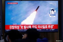 People in Seoul, South Korea, watch a TV broadcasting file footage for a news report on North Korea firing an unidentified projectile, Nov. 28, 2019.