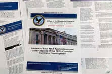 The report issued by the Department of Justice inspector general is photographed in Washington, Monday, Dec. 9, 2019. The…