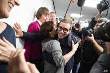 German Jens Soering, center, is embraced by Bernadette Faber after his arrival at the Frankfurt Airport in Frankfurt, Germany,…