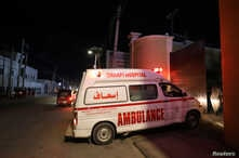 An ambulance carrying an injured person from an attack by Al Shabaab gunmen on a hotel near the presidential residence arrives…
