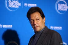 Pakistan's Prime Minister Imran Khan arrives for the Global Refugee Forum at the United Nations in Geneva, Switzerland,…