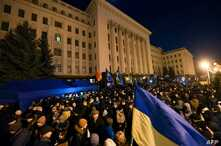 "Activists attend a ""Night Watch"" rally in front of the Office of Ukraine's President, in Kyiv, Dec. 8, 2019, demanding ""no capitulation"" ahead of Volodymyr Zelenskiy's talks with Russia's Vladimir Putin in Paris Monday."